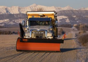 Mack truck with Tenco snow plow and combination body spreader